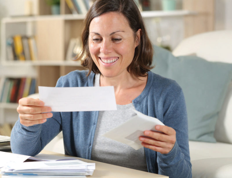 woman looking at a check