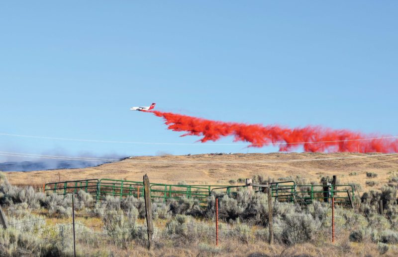 A plane drops fire retardant on the Substation Fire.