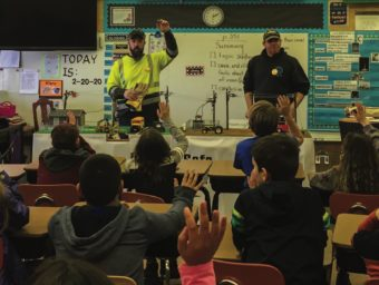 Northern Wasco County PUD Lineman Ryan Mancui, left, and Wasco Electric Lineman Andy Gardipee ask students how to be safe around electricity.