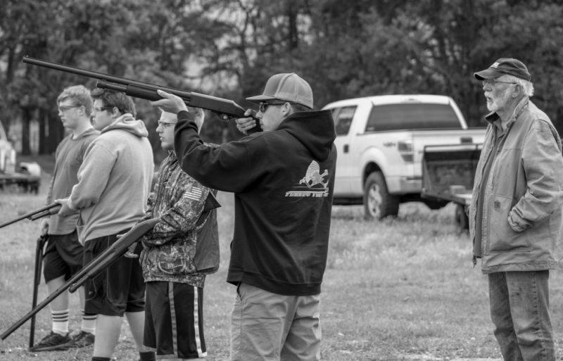 Teenagers doing target practice