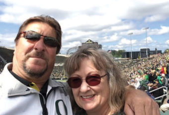 Bo Gridley with his wife at a stadium.