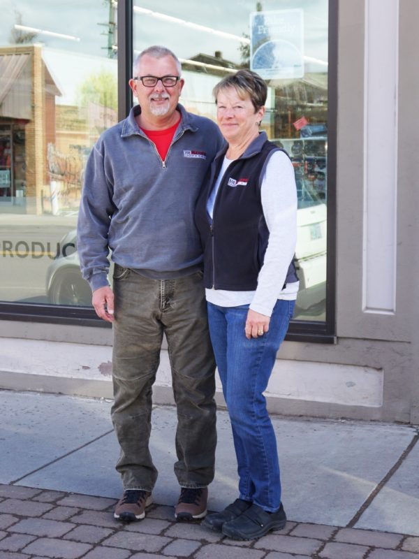 Randy and Allison Bechtol stand outside their market